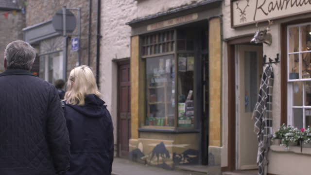 sequence showing a secondhand bookshop named 'murder mayhem' in hayonwye powys wales rushes taken from bbccom/culture ww absa734n - powys stock videos & royalty-free footage