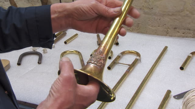 sequence showing a 'smithwright' royal trumpet being constructed which will be used in the wedding of prince harry and meghan markle - metal blend stock videos and b-roll footage