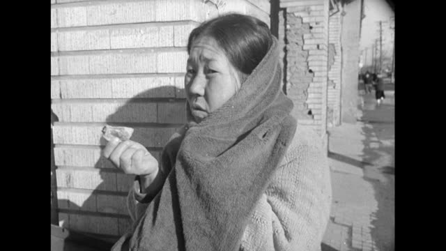 sequence showing a stall selling food to people in the ruins of postwar seoul. - korean war stock videos & royalty-free footage