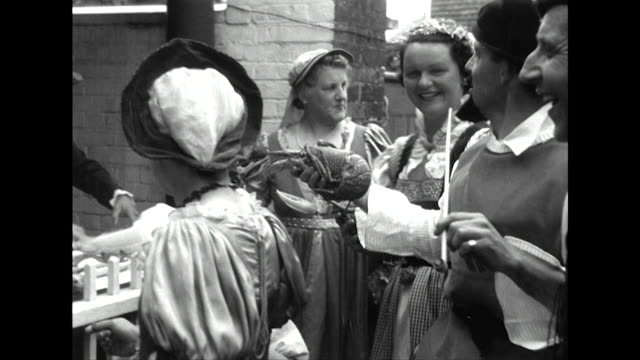 sequence showing a traditional tudor market selling fish in the village of chipstead as part of the festival of britain celebrations - festival of britain stock videos & royalty-free footage