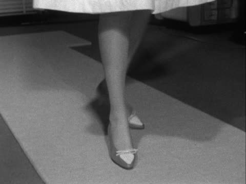 stockvideo's en b-roll-footage met sequence showing a woman modelling a pair of shoes - dameskleding