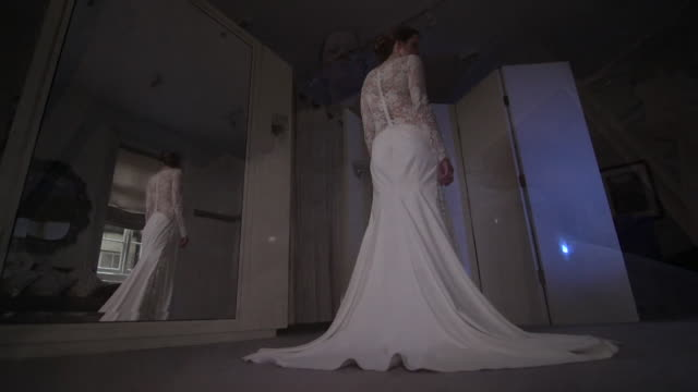 sequence showing a women modelling a white lace wedding dress - lace textile stock videos & royalty-free footage