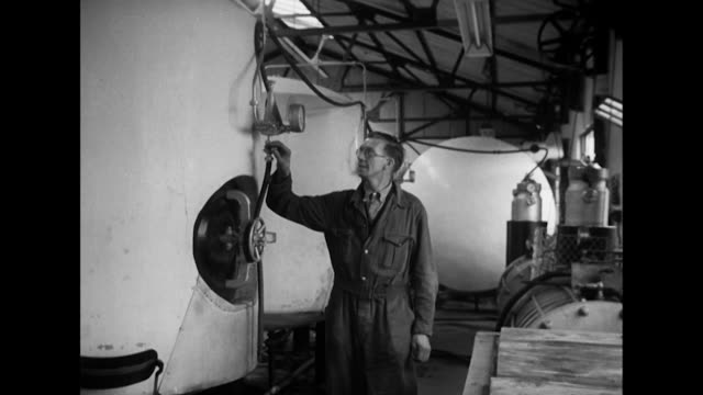 Sequence showing a worker checking large tanks of cider at a cider factory