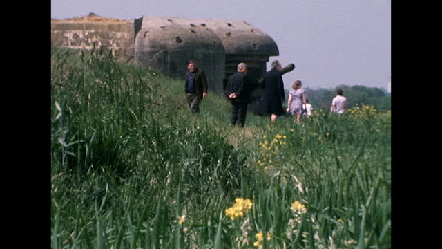 sequence showing abandoned military defences and large gun barrel left on the normandy coast after world war 2 on the 30th anniversary of the d-day... - focus on foreground stock videos & royalty-free footage