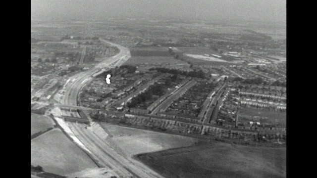 sequence showing aerial shots over the nearly completed section of the m6 motorway running from south end to st albans - motorway stock videos & royalty-free footage