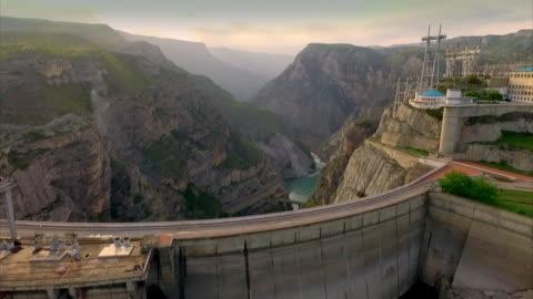 stockvideo's en b-roll-footage met sequence showing aerial views of a hydroelectric dam in dagestan, russia. - dam mens gemaakte bouwwerken