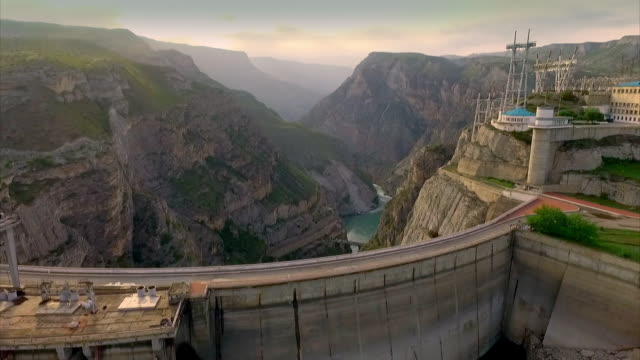 Sequence showing aerial views of a hydroelectric dam in Dagestan, Russia.