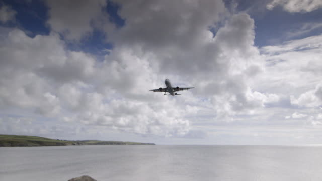 sequence showing aeroplanes taking off and landing at isle of man airport. - taking off stock videos & royalty-free footage