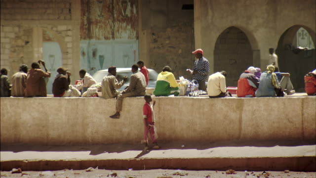 Sequence showing African migrants on the streets of Tamanrasset, Algeria.
