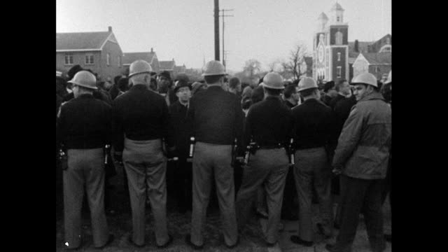 vídeos de stock, filmes e b-roll de sequence showing alabama highway patrol troopers preventing african american and caucasian citizens from registering to vote at the selma courthouse;... - 1965