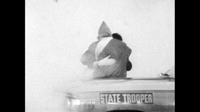 stockvideo's en b-roll-footage met sequence showing alabama state troopers attempting to disperse marchers at selma with tear gas on bloody sunday - marchers kneeling on the ground. /... - 1965
