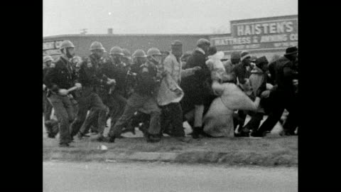 sequence showing alabama state troopers charging marchers during the selma marches on bloody sunday; 7th march 1965 - marchers are pushed and fall to... - 1965 stock videos & royalty-free footage
