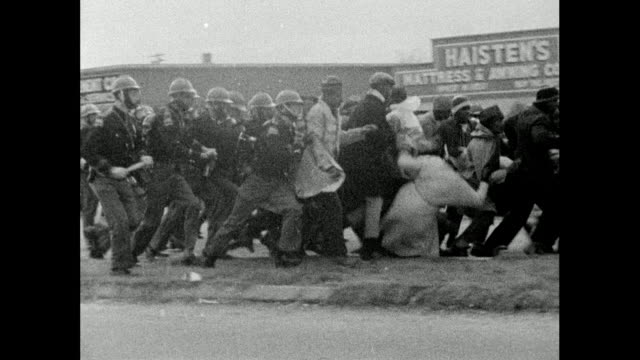 vídeos de stock, filmes e b-roll de sequence showing alabama state troopers charging marchers during the selma marches on bloody sunday; 7th march 1965 - marchers are pushed and fall to... - 1965