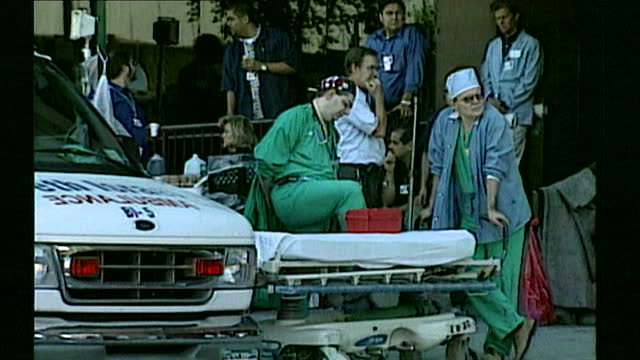 sequence showing ambulances and doctors waiting outside st. vincent's hospital to receive patients found in the rubble of the world trade centre; new... - world trade center manhattan stock videos & royalty-free footage