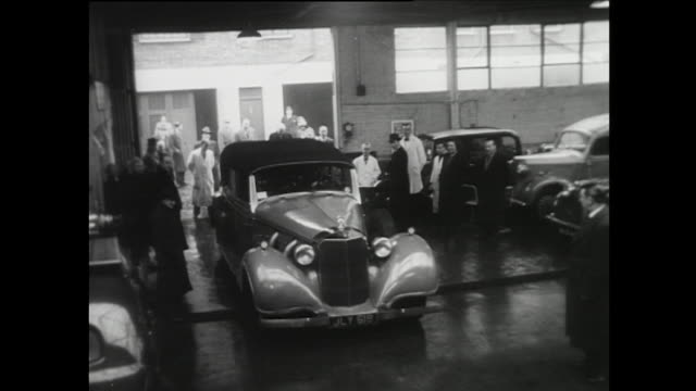 sequence showing an auction in london of a bullet proof car once owned by hermann goering - postwar stock videos and b-roll footage