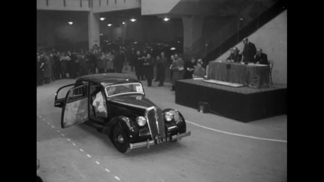 Sequence showing an auction of second hand cars at Olympia exhibition hall