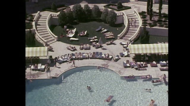 sequence showing an outdoor hotel swimming pool and golf course in las vegas - gambling stock videos and b-roll footage