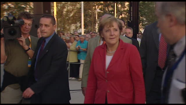 sequence showing angela merkel arriving at a political rally in 2005. rear view of crowd eager to see angela merkel. angela merkel walking with... - 2005 stock-videos und b-roll-filmmaterial