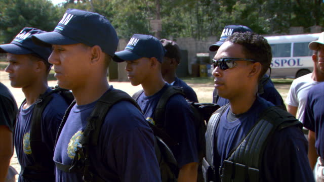 Sequence showing anti-narcotics police of the Dominican Republic (DICAN) carrying out exercises at a training base.