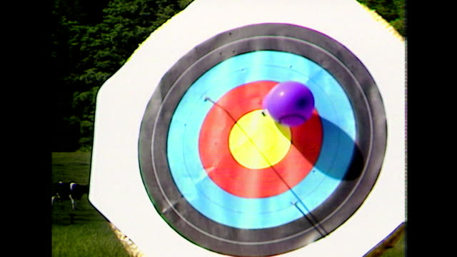 sequence showing arrows in colourful bullseye target; 1984 - pointing stock videos & royalty-free footage