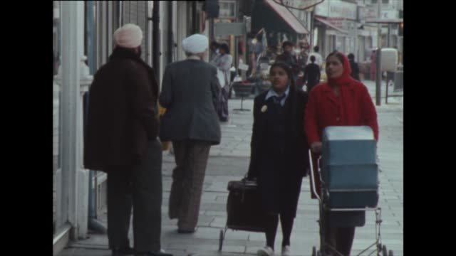 sequence showing asian families in southall, london in 1982 - multiculturalism stock videos & royalty-free footage
