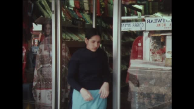 sequence showing asian women outside a fabric shop in southall, london in 1982 - multiculturalism stock videos & royalty-free footage