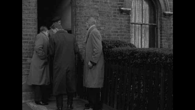 Sequence showing bailiffs taking a piece of furniture away from a house