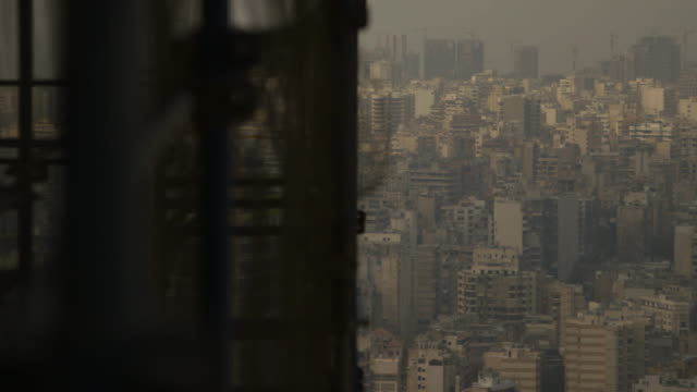 sequence showing beirut's cityscape seen from an elevated building site, lebanon. - 人口爆発点の映像素材/bロール