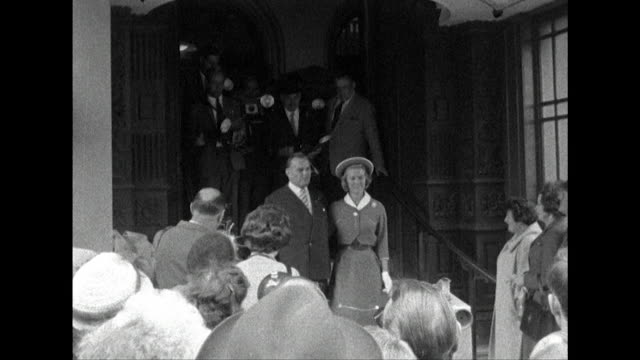 sequence showing billy butlin leaving caxton hall with his new wife. - holiday camp stock videos & royalty-free footage