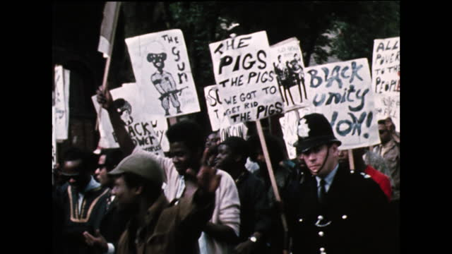 sequence showing black power movement supporters and protestors marching with police officers to demonstrate against the repeated raids on the... - capital cities stock videos & royalty-free footage
