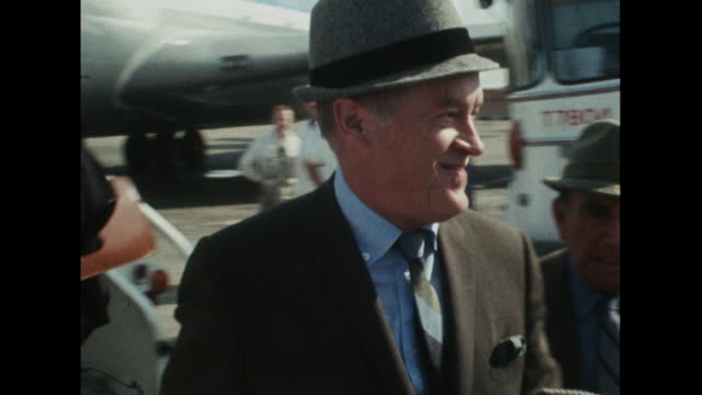 sequence showing bob hope arriving at london airport. - celebrities stock-videos und b-roll-filmmaterial