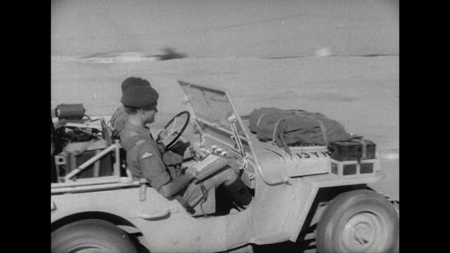 sequence showing british army troops driving jeeps across the desert in the suez canal zone. - suez canal stock videos & royalty-free footage