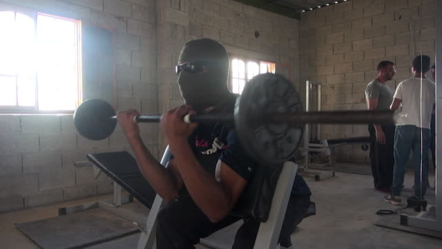 Sequence showing British jihadists working out in a home gym in the city of Idlib Syria