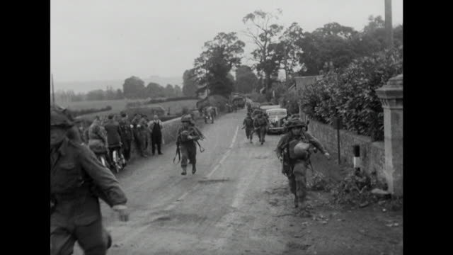Sequence showing British servicemen taking part in a 'mock war' exercise near Salisbury