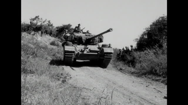 Sequence showing British tanks travelling across the South Korean countryside