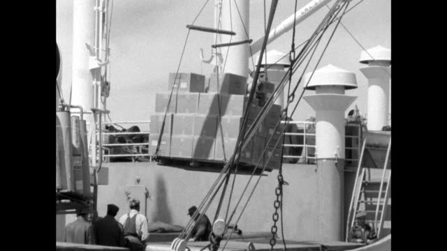 Sequence showing cargo being loaded onto a ship in New York