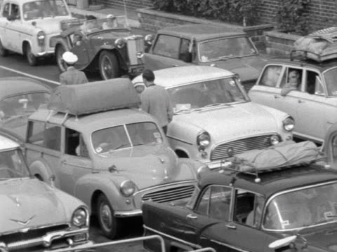 sequence showing cars lining up to board ferries to france and belgium from dover. 1963. - ferry stock videos & royalty-free footage