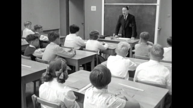sequence showing children entering a classroom and starting a school lesson - 1950 1959 stock videos & royalty-free footage