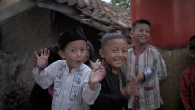 sequence showing children in an indonesian community next to the river citarum. - indonesia street stock videos & royalty-free footage