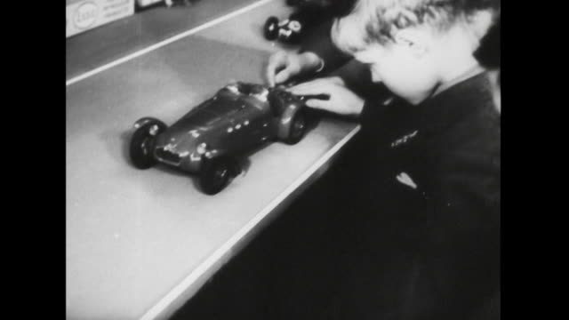 sequence showing children looking at toy cars at a model racing car exhibition in london. - sammlung stock-videos und b-roll-filmmaterial