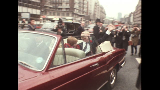 sequence showing cilla black and bobby willis driving away in a rolls royce following their wedding ceremony at marylebone registry office - rolls royce stock videos & royalty-free footage