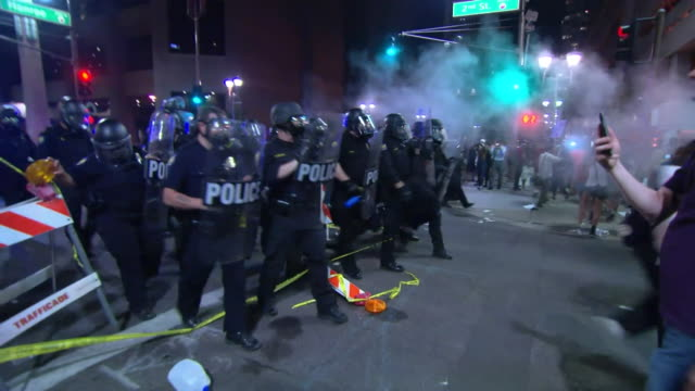 sequence showing clashes between police and protesters in phoenix arizona following a rally by donald trump usa [nb only the first shot has sound]... - obscene gesture stock videos and b-roll footage