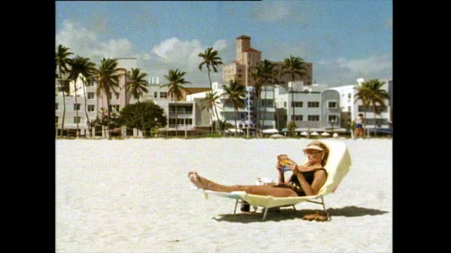 sequence showing clean beaches in miami; 1991 - semi dress stock videos & royalty-free footage