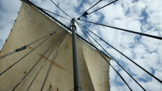 Sequence showing close-ups of a replica of an eleventh century Viking ship whilst sailing.