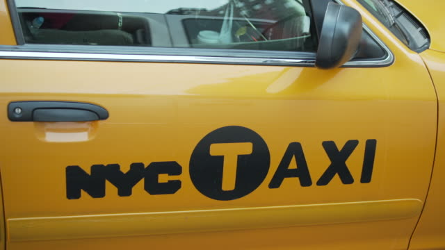 Sequence showing close-ups of a yellow 'medallion' taxicab in motion in New York City, USA.