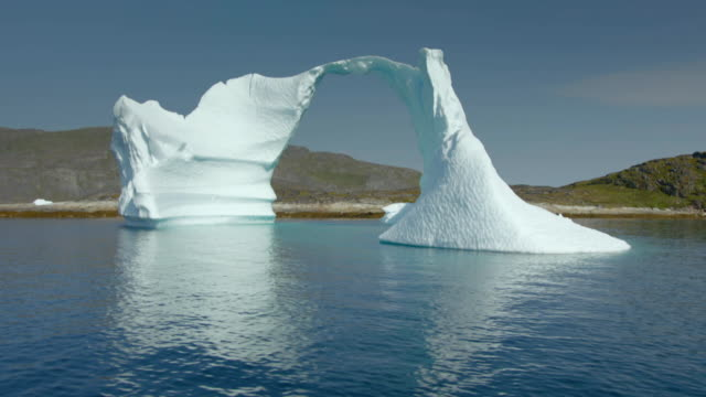 Sequence showing close-ups of icebergs as seen from a rubber dinghy.