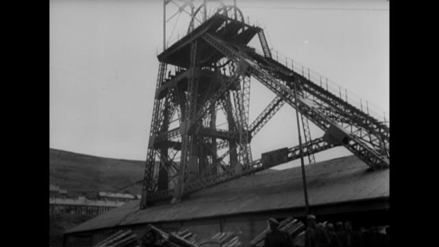 sequence showing coal miners leaving a pithead. - coal miner stock videos & royalty-free footage