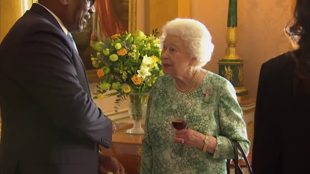 sequence showing commonwealth leaders the queen and prince charles drinking alcohol in an ornate room in windsor castle uk - windsor castle stock videos & royalty-free footage