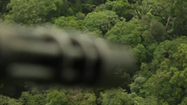 sequence showing counter narcotics police embarking on a raid on an illegal coca crop in columbia - rainforest stock videos & royalty-free footage