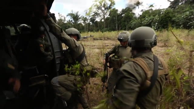 sequence showing counter narcotics police leaving a raid on an illegal coca crop in columbia on a helicopter - smoke physical structure stock videos & royalty-free footage